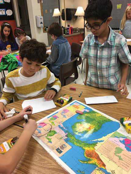 Students working with map