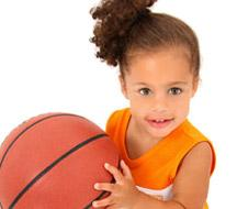 Girl holds basketball